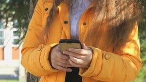 School girl views her photos using a smartphone stock video