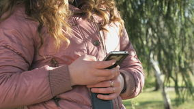 School girl views her photos using a smartphone stock footage