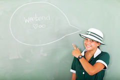 School girl weekend. Cheerful teenage school gril thinking about the weekend in classroom Royalty Free Stock Photos