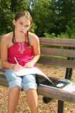 School Girl Working on Difficult Homework Royalty Free Stock Photo