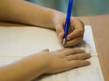 School girl writing closeup. Pencil in hand. Royalty Free Stock Images