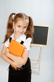 School girl with yellow book Stock Photo
