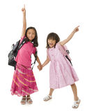 School Girls. Two young asian school girls ready for school Royalty Free Stock Photography