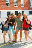 School girls. Portrait of a group of young smiling school girls in schoolyard Stock Photography