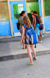 School girls. Group of young girls entering school building royalty free stock photos