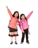 School Girls. Two young asian school girls ready for school Royalty Free Stock Photo