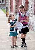 School Girls with Notebook Royalty Free Stock Photography
