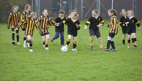 School girls playing soccer/football Stock Photo