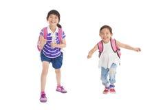 School girls running together Stock Photos