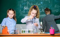 School girls study. Explore biological molecules. Future technology and science concept. Kids in classroom with stock photo