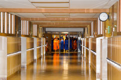 School Graduation. The long awaited day of graduation is upon them waiting patiently in the hallway they have grown in over the years waiting to walk across the royalty free stock photos