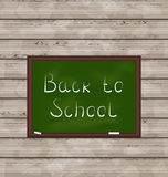 School green board on wooden texture Royalty Free Stock Photography
