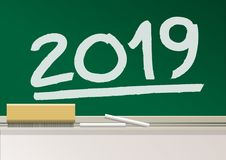 The year 2019 is written in chalk on the chalkboard of a school class. royalty free illustration