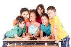 School. Group of kids looking at globe at school isolated in white Stock Image
