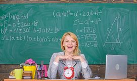 School. Home schooling. happy woman. Back to school. Teachers day. woman in classroom. teacher with alarm clock at. School. Home schooling. happy woman. Back to royalty free stock image