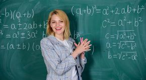 School. Home schooling. happy woman. Back to school. Teachers day. teacher on school lesson at blackboard. woman in. Classroom. Study and education. Modern stock photos