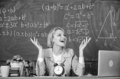 School. Home schooling. happy woman. teacher with clock at blackboard. Back to school. Teachers day. woman in classroom. Study and education. Modern school royalty free stock image