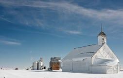 School house in farm country with grain silos Stock Photos