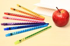 School. Image of an apple on a table with pencils Stock Photos