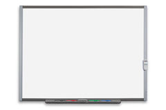 Interactive whiteboard isolated. School interactive whiteboard or IWB with remote control, isolated on a white background. Clipping path provided for both the Royalty Free Stock Photos