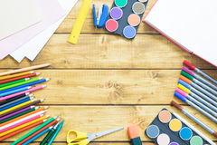 School items make a frame on wooden background Stock Photos