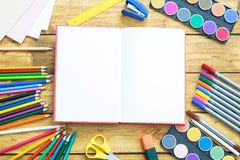 School items make a frame on wooden background. With a space for your text Stock Photos