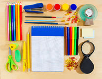School items making frame on wooden background with a space for your text. Royalty Free Stock Images