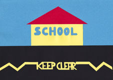 School Keep Clear. Cut out shapes image illustrating safety road marking outside school stock illustration