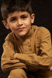 School Kid. Young south asian looking at camera royalty free stock photography