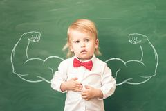 Back to school. Education concept. School kid in class. Happy child against green blackboard. Education concept royalty free stock image