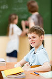 School kid in classroom at lesson Stock Photography