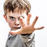 School kid defending himself against danger, stopping violence, contrast effects. Fighting school kid defending himself against danger, stopping violence Royalty Free Stock Images