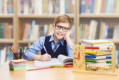 School Kid Education, Student Boy Studying Books, Little Child i. N Glasses, Abacus clock in Library Stock Photo