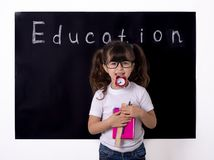School kid holding supplies. Clever kid in school. Back to school. Smart kid royalty free stock photos