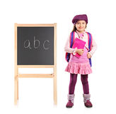 School kid posing next to a school board Royalty Free Stock Photos