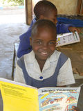 School kid  reading indigeneous language textbook. Stock Images