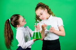 School kid scientist studying science. biology education. little smart girls with testing flask. children study. Chemistry lab. back to school. I love my job stock image
