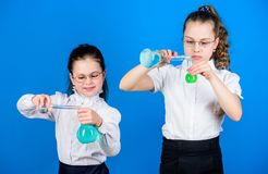 School kid scientist studying science. little smart girls with testing flask. children study chemistry lab. biology. Education. back to school. Checking the royalty free stock photography