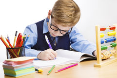 School Kid Writing, Student Child Learn in Classroom, Young Boy in. Glasses Write, Education stock image