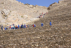 School kids in blue climbing agricultural terraces Royalty Free Stock Images