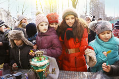 School kids celebrate Maslenitsa Pancake Week. Moscow, Russia Februar 16, 2017: Unidentifyed school kids celebrate Maslenitsa Pancake week - purely Russian royalty free stock photo