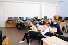 School kids in class. School kids of elementary school in class during the lesson stock photo