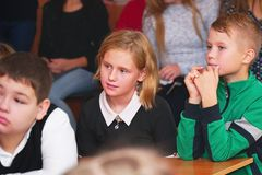 School kids in the classroom listen to the teacher royalty free stock photography