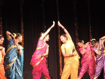 School kids dancing on annual day event, Maharashtra, India. School kids performing Maharashtrian dance on annual day event. They are wearing colorful Stock Image