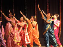 School kids dancing on annual day event, Maharashtra, India. School kids performing Maharashtrian dance on annual day event. They are wearing colorful Royalty Free Stock Photography