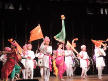 School kids dancing on annual day event, Maharashtra, India. School kids performing Maharashtrian dance on annual day event. They are wearing traditional royalty free stock images