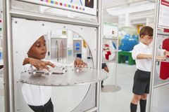 School kids doing science tests at a science centre royalty free stock image