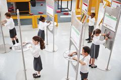 School kids doing science tests at a science centre royalty free stock images