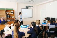 CHAPAEVSK, SAMARA REGION, RUSSIA - DECEMBER 07, 2017: School kids in class with teacher woman royalty free stock photo