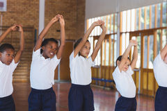 School kids exercising in basketball court Royalty Free Stock Photography